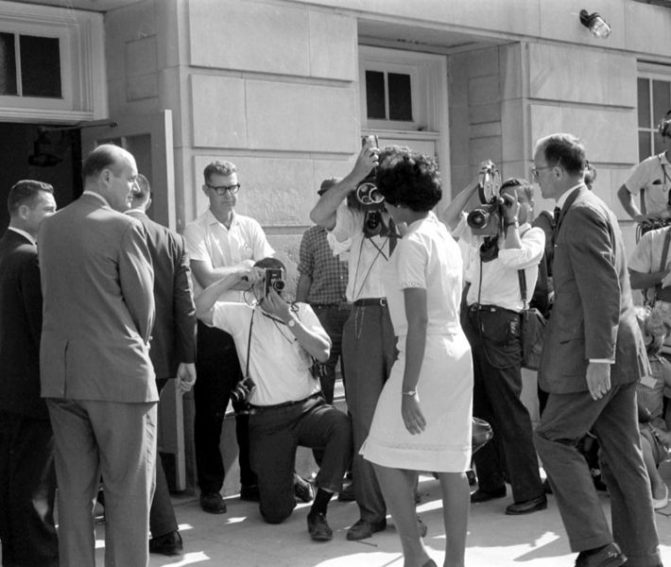 When Wallace stepped aside, Vivian Malone Jones entered the auditorium to register for classes.